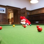 Santa plays snooker