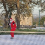 Santa has a quick game of tennis