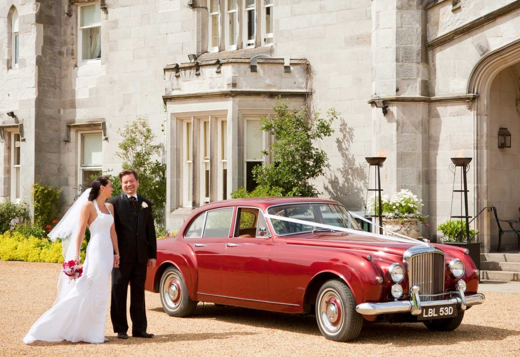 Dundas Wedding Couple in front of Bentley