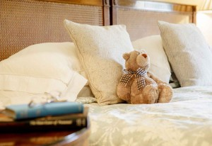 Spring bedroom with teddy